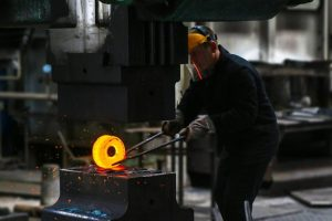 Man Working With Metal At Manufacturing Business in Florida