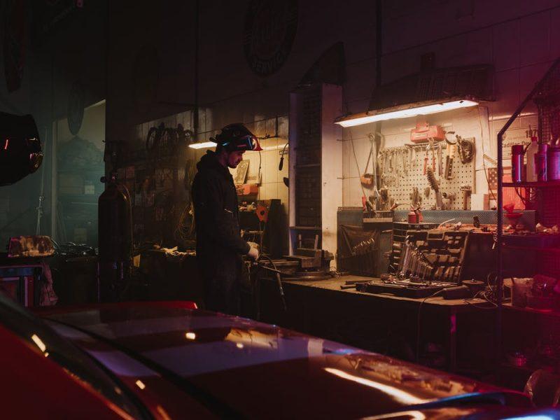 An auto technician working in an auto repair shop
