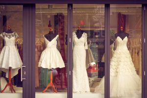 wedding gowns and dresses on display at a boutique. successfully run a clothing business