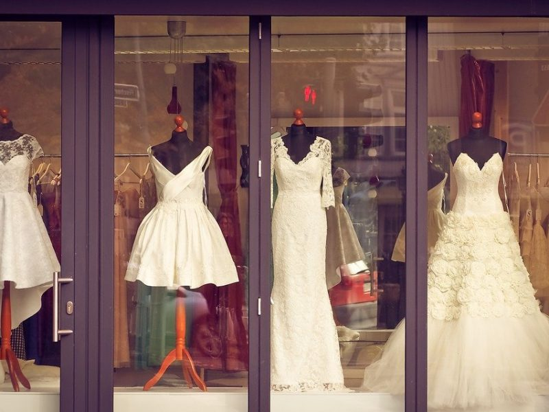 wedding gowns and dresses on display at a boutique