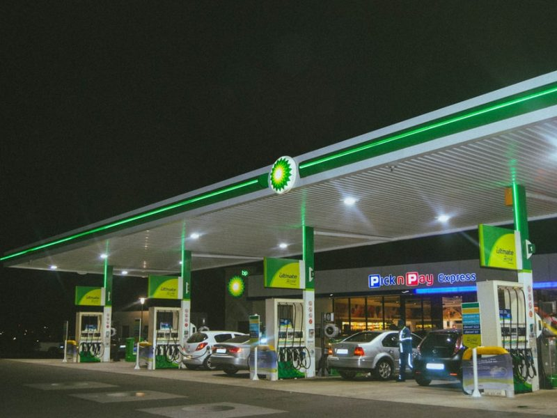 A well-lit gas station with a convenience store.