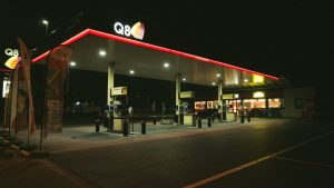 An image of a gas station at night.